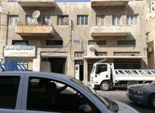 عماره مكونه من اربعة مخازن شارع الامير محمد