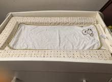 baby cot and changing table