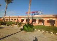 محلات للايجار واجهة فندق وعلي الشارع الرئيسي