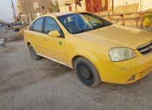 سياره اوبترا موديل 12 للبيع رقم بغداد والسياره موجوده بالعماره