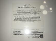brand new white Ipad (sealed box) مختوم مع علبته