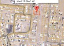 ارض سكني تجاري كورنر في صلال شرق جنب المدرسه الثانويه للبنات