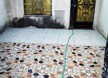 للبيع بيت تجاوز في منطقة حي الجامعة شارع حسينية أصحاب الكساء مجاور مدرسة الحسين