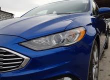 SE Ford Fusion 2017 مع فتحة لون ازرق 4 جيد