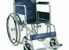 كرسي متحرك جديد بالكرتون لم يستعمل