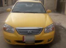 Yellow Kia Spectra 2009 for sale