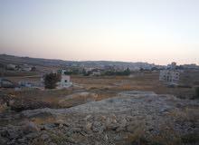 ارض للبيع شارع المطار مقابل ايكيا خلف جامعه الزيتونه1012متر0797720567