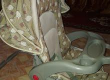 سرير طفل مستخدم + كرسي هزاز