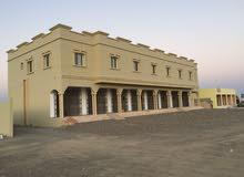 مبنى وارض صناعية للإيجار