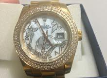 ساعة روليكس مطليه بالذهب ومرصع بالألماس بسعر مميز