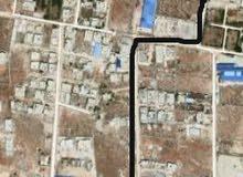 قطعة أرض بمنطقة ابوعطني مقابل صيدلية الرواد