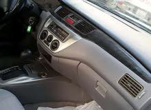 للبيع سياره لانسر موديل 2006 جير مكينه تكيف 100%
