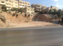 ارض للبيع على اتوستراد عمان الزرقاء 841م