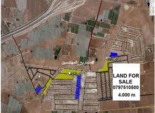 قطعة أرض على طريق المطار في منطقة الـذهيبة الغربية للبيع تبعد عن مشروع المهندسين نمرة واحدة