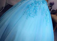 Turquoise engagement dress with see thru gorset