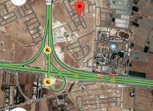 أرض للبيع 620م في الطنيب حوض العيادات جانب جامعة الإسراء منطقة فلل ومرتفعه