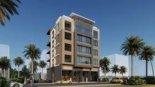 أرض تجارية للبيع -موقع ممتاز للاستثمار وسط كثافة سكانية - بعجمان - على ش الشيخ محمد بن زايد مباشرةَ