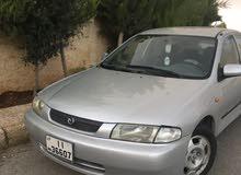 Silver Mazda 323 1998 for sale
