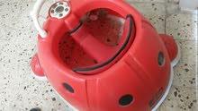 حجلة طفل تركية، شكل دعسوقه، مع مؤثرات صوتية، نظيفة جداً بـ 39 ألف