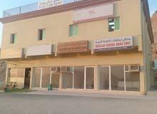 بناية للبيع لها دخل 150 ألف درهم فى عجمان على الشارع العام