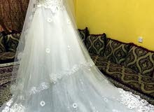 فستان زفاف جديد غير ملبوس بمستلزماته الطرحه والجيبون والجوتي والسواعد للبيع  20