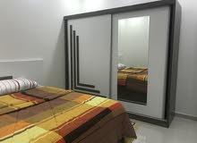 غرفة نوم و أسرة