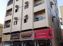 بناية و معرض للبيع بعجمان بدخل 400 ألف على شارع رئيسي تملك كل الجنسيات