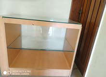 top middle glass wooden table