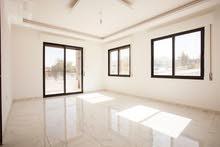 شقة 127مترمربع طابق اول مميزة  واطلالة رائعة في الجبيهة