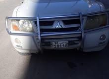 سياره مستوبيشي جيب  باجيرو 2004 كامله بحاله ممتازه 3شاشه