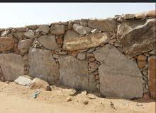 مقاول بناء حجر وتسوير اراضي