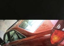 Maroon Toyota Avalon 2000 for sale