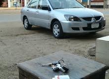 سياره لانسر بوما موديل 2005