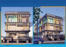 محلات بمساحات مختلفه بالتجمع بالمول الرئيسي بمنطقة خدمات البنفسج