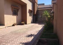 حوش ارضي راقي للبيع ماشاءالله في عين زارة بالقرب من اربع شوارع زاويته، علي واجهت