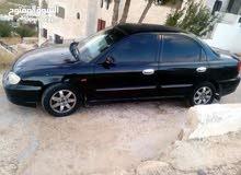 Kia Spectra car for sale 2000 in Salt city