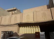 بيت للبيع في  منطقة الاسكان ..شارع كلية  بغداد للعلوم الاقتصادية