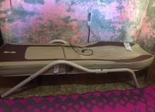 سرير لجلاسات الظهر والرقبه