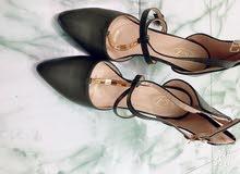 حذاء زيتوني عالي ذات كعب مميز ...جديد..قياس 39 للحفلات والمناسبات والعرائس
