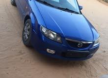 مازد 323 موديل 2003 محرك16 اوتوماتيك كيلومتر155 جمرك