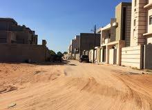 قطعة ارض للبيع 300م وجهتين منطقة فرحات العكاري بالقرب من جزيرة مسجد الشريف