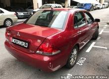 Automatic Maroon Mitsubishi 2012 for sale