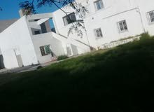 ارض للبيع على الطريق الرئيسي مساحتها الجملية 1500 م 22031263