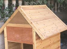 بيت كلب خشبي