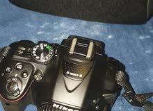 كاميرا نيكون احترافية بملحقاتها