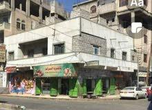 عمارة مسلح دورين في قلب العاصمة صنعاء