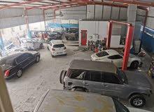 مركز خدمة سيارات للبيع بسعر مغري في صناعية العين