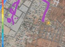 قطعة ارض 500متر بوصنيب خلف الحضيرة الجمركية ضي وقطران ومية وجيران ماشاء اللة