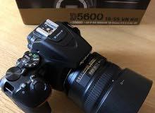 كاميرا نيكون مع عدسات وبطاريتين