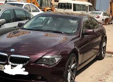 2006,maroon colored BMW 650i,2 door,